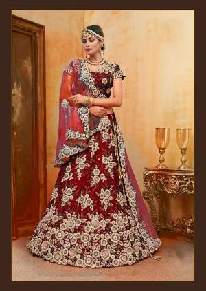 Be The Prettiest Bride Wearing This Very Beautiful And Heavy Embroidered Designer Bridal Lehenga Choli In Red Color Paired With Contrasting Baby Pink Colored Dupatta. This Lehenga Choli Is Velvet Based Paired With Net Fabricated Dupatta. Buy This Beautiful Lehenga Choli Now.
