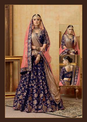 Get Ready For Your D-Day With This Heavy Designer Bridal Lehenga?Choli In Dark Blue Color Paired With Contrasting Pink Colored Dupatta. Its Heavy Embroidered Blouse And Lehenga Are Fabricated On Velvet Paired With Net Fabricated Dupatta.