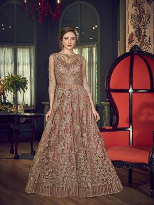 Rich And Elegant Looking Dual Look Indo-Western Dress In Pastel Brown Color. Its Jacket Is Fabricated On Net Paired With Embroidered Santoon Pants And Satin Lehenga With An Elegant Chiffon Fabricated Dupatta.