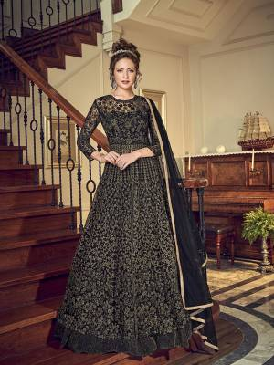 For A Bold And Beautiful Look, Grab This Designer Indo-Western Pair In All Over Black Color. Its Embroidered Top Is Net Based Paired With Santoon Bottom And Chiffon Fabricated Dupatta. Also For Another Look It Comes With A Satin Fabricated Lehenga.
