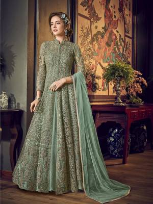 Look Pretty In This Subtle Shade Of Green That With This Designer Indo-Western Pair In Pastel Green Color. Its Top IS Fabricated On Net Bautified With Heavy Embroiderey Comes With A Fancy Crushed Satin Inner Paired With Santoon Bottom And Chiffon Fabricated Dupatta.