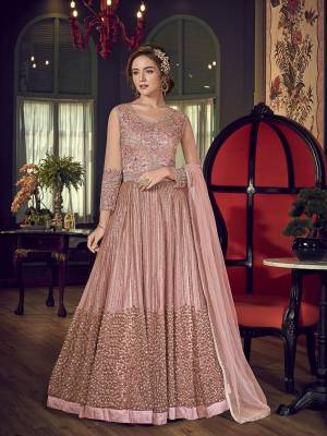 You Will Definitely Earn Lots Of Compliments Wearing This Heavy Designer Floor Length Suit In Baby Pink Color. Its Heavy Embroidered Top Is Fabricated On Net Paired With Santoon Bottom And Chiffon Fabricated Dupatta.