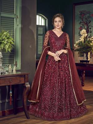 For A Royal Look, Grab This Lovely Maroon Colored Ino Westen pair Which Comes With Pants And Lehenga. Its Top IS Net Based Paired With Satin Lehenga And Chiffon Fabricated Dupatta. For A More Trendy Look, You can Pair Up With Its Lovely Embrodered Santoon Fabricated Pants.