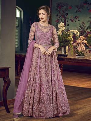 Look Pretty In This Pretty Shade Of Pink That With This Designer Indo-Western Pair In Mauve Pink Color. Its Top IS Fabricated On Net Bautified With Heavy Embroiderey Comes With A Satin Inner Paired With Santoon Bottom And Chiffon Fabricated Dupatta.