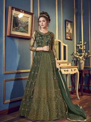 For The Upcoming Wedding And Festive Season,  Grab This Very Beautiful And Heavy Designer Indo-Western Dress In Pine Green Color. Its Top IS Fabricated On Net And Satin Paired With Santoon Bottom And chiffon Fabricated Dupatta. Also It Has A Satin Fabricated Lehenga , so That You Can Pair With Any Of The Bottoms As Per The Occasion.