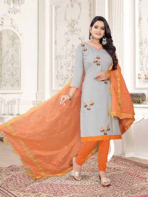 Here Is A Pretty Dress Material For Your Casual Or Semi-Casual Wear In Grey And Orange Color. Its Top Is Fabricated On Cotton Slub Paired With Cotton Bottom And Cotton Silk Fabricated Dupatta. Get This Stitched As Per Your Desired Fit And Comfort.
