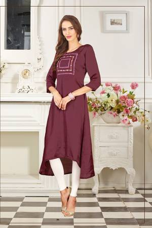 Add This Lovely Color To Your Wardrobe In Wine Colored Readymade Kurti Fabricated On Soft Satin Silk. Its Fabric Is Soft Towards Skin And Easy To Carry All Day Long.