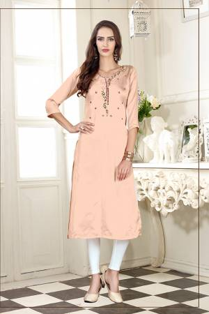A Must Have Shade In Every Womens Wardrobe Is Here With This Readymade Straight Kurti In Light Peach Color. This Kurti Is Fabricated On Soft Satin Silk Beautified With Subtle Thread work.