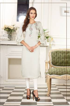 Simple And Elegant Looking Designer Straight Kurti IS Here In Off-White Color Fabricated On Soft Satin Silk. This Pretty Kurti Can Be Paired With Same Of Contrasting Colored Leggings Or Pants. Also Its Fabric Ensures Superb Comfort All Day Long.
