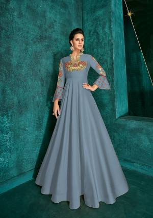 Celebrate This Festive Season Wearing This Designer Readymade Gown In Steel Blue Color Fabricated On Soft Art Silk Beautified With Embroidery. Its Rich Fabric And Color Will Definitely Earn You Lots Of Compliments From Onlookers.?