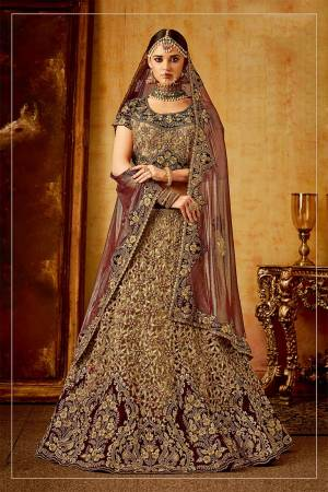Get Ready For Your D-Day With This Heavy Designer Bridal Lehenga?Choli In Maroon And Beige Color Paired With Maroon Colored Dupatta. Its Heavy Embroidered Blouse And Lehenga Are Fabricated On Velvet Paired With Net Fabricated Dupatta