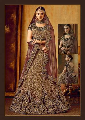 Be The Prettiest Bride Wearing This Very Beautiful And Heavy Embroidered Designer Bridal Lehenga Choli In Maroon And Dark Beige Color Paired With Maroon Colored Dupatta. This Lehenga Choli Is Velvet Based Paired With Net Fabricated Dupatta. Buy This Beautiful Lehenga Choli Now