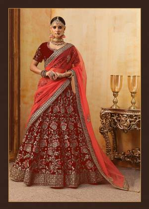 Be The Prettiest Bride Wearing This Very Beautiful And Heavy Embroidered Designer Bridal Lehenga Choli In Red Color Paired With Red Colored Dupatta. This Lehenga Choli Is Velvet Based Paired With Net Fabricated Dupatta. Buy This Beautiful Lehenga Choli Now