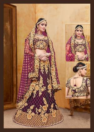 Get Ready For Your D-Day With This Heavy Designer Bridal Lehenga?Choli In Purple Color Paired With Purple Colored Dupatta. Its Heavy Embroidered Blouse And Lehenga Are Fabricated On Velvet Paired With Net Fabricated Dupatta