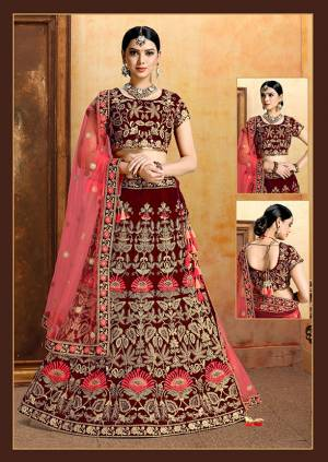 Get Ready For Your D-Day With This Heavy Designer Bridal Lehenga?Choli In Maroon Color Paired With Contrasting Crimson Red Colored Dupatta. Its Heavy Embroidered Blouse And Lehenga Are Fabricated On Velvet Paired With Net Fabricated Dupatta