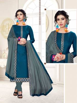 Rich And Elegant Looking Dress Material Is Here In Blue Color Paired With Contrasting Grey Colored Bottom And Dupatta. Its Top Is Fabricated on Cotton Slub Paired With Cotton Bottom And Chiffon Fabricated Dupatta.