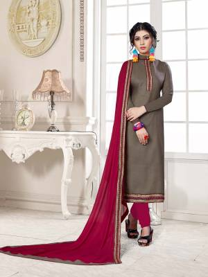If Those Readymade Suit Does Not Lend You The Desired Comfort Than Grab This Cotton based Dress Material With Chiffon Dupatta And Get This Stitched As Per Your Desired Fit And Comfort. Its Top IS In Sand Grey Color Paired With Contrasting Magenta Pink Colored Bottom and Dupatta. Buy Now.