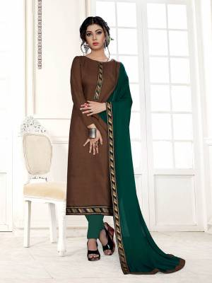 For Your Semi-Casual Wear, Grab This Pretty Dress Material In Brown Color Paired With Contrasting Pine Green Colored Bottom And Dupatta. Its Top Is Fabricated On Cotton Slub Paired With Cotton Bottom And Chiffon Fabricated Dupatta.