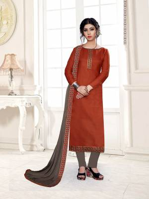 Enhance Your Personality Wearing This Designer Straight Suit In Rust Orange Color Paired With Contrasting Grey Colored Bottom and Dupatta. This Dress Material Is Cotton Based Paired With Chiffon Fabricated Dupatta. Buy This Dress Material Now.