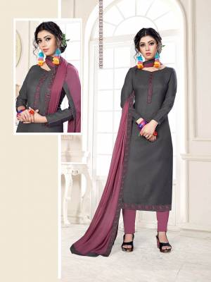 If Those Readymade Suit Does Not Lend You The Desired Comfort Than Grab This Cotton based Dress Material With Chiffon Dupatta And Get This Stitched As Per Your Desired Fit And Comfort. Its Top IS In Dark Grey Color Paired With Contrasting Mauve Pink Colored Bottom and Dupatta. Buy Now.