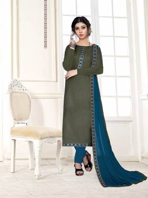 For Your Semi-Casual Wear, Grab This Pretty Dress Material In Olive Green Color Paired With Contrasting Blue Colored Bottom And Dupatta. Its Top Is Fabricated On Cotton Slub Paired With Cotton Bottom And Chiffon Fabricated Dupatta.
