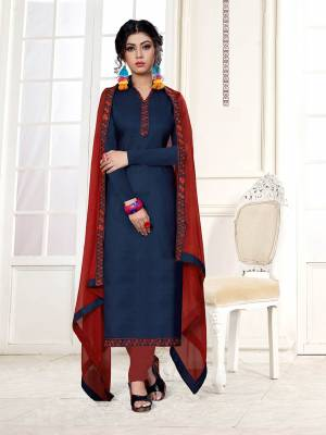 Lovely Color Pallete Is Here With This Dress Material In Navy Blue Color Paired With Contrasting Red Colored Bottom And Dupatta. This Dress Material Is Cotton Bottom Paired With Chiffon Fabricated Dupatta, Get This Stitched As Per Your Desired Fit And Comfort.