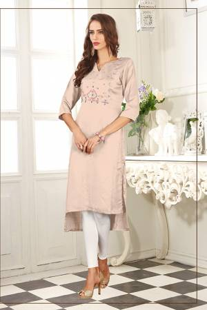 For Your Semi-Casuals, Grab This Readymade Pretty Kurti In Pastel Peach Color Fabricated On Soft Satin Silk. It Is Beautified With Contrasting Thread Work and Also It Is Light Weight And Easy To Carry All Day Long.