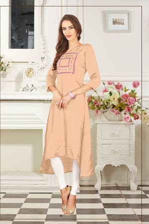 Add This Lovely Color To Your Wardrobe In Peach Colored Readymade Kurti Fabricated On Soft Satin Silk. Its Fabric Is Soft Towards Skin And Easy To Carry All Day Long.