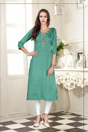 A Must Have Shade In Every Womens Wardrobe Is Here With This Readymade Straight Kurti In Light Sea Green Color. This Kurti Is Fabricated On Soft Satin Silk Beautified With Subtle Thread work.