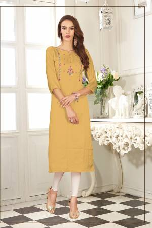 Look Pretty In This Readymade Straight Kurti In Musturd Yellow Color. It Is Fabricated On Soft Satin Silk Beautified With Thread Work.