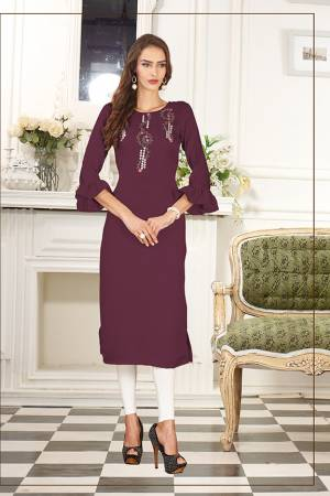 Simple And Elegant Looking Designer Straight Kurti IS Here In Wine Color Fabricated On Soft Satin Silk. This Pretty Kurti Can Be Paired With Same Of Contrasting Colored Leggings Or Pants. Also Its Fabric Ensures Superb Comfort All Day Long.