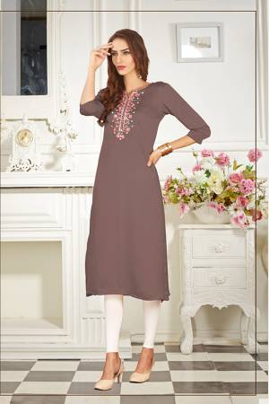 A Must Have Shade In Every Womens Wardrobe Is Here With This Readymade Straight Kurti In Mauve  Color. This Kurti Is Fabricated On Soft Satin Silk Beautified With Subtle Thread work.