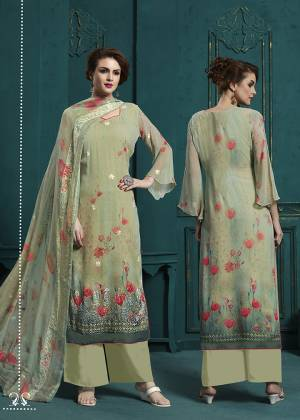 This Season Is About Subtle Shades And Pastel Play, So Grab This Very Pretty Designer Straight Suit In Pastel Green Color. Its Top And Dupatta Are Fabricated On Georgette beautified With Digital Pints And Resham Work Paired With Santoon Fabricated Bottom.