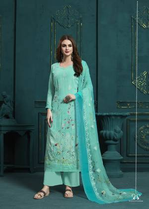 Add This Very Pretty Designer Straight Suit In All Over Turquoise Blue Color. Its Top And Dupatta are Georgette Based Beautified With Digital Prints And Resham Work Paired With Santoon Fabricated Bottom. Buy This Semi-Stitched Now.