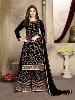 Grab This Attractive Looking Heavy Embroidered Plazzo Suit In Black Color. Its Embroidered Top Is Fabricated On Soft Silk Paired With Georgette Bottom And Net Fabricated Dupatta. Its Top And Bottom Are Beautified With Heavy Jari Embroidery And Stone Work.