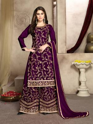 Grab This Attractive Looking Heavy Embroidered Plazzo Suit In Purple Color. Its Embroidered Top Is Fabricated On Soft Silk Paired With Georgette Bottom And Net Fabricated Dupatta. Its Top And Bottom Are Beautified With Heavy Jari Embroidery And Stone Work.