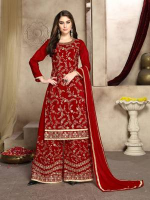 Grab This Attractive Looking Heavy Embroidered Plazzo Suit In Red Color. Its Embroidered Top Is Fabricated On Soft Silk Paired With Georgette Bottom And Net Fabricated Dupatta. Its Top And Bottom Are Beautified With Heavy Jari Embroidery And Stone Work.