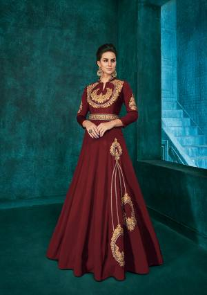 Bright And Visually Appealing Color Is Here With This Very Beautiful Designer Readymade Gown In Maroon Color Fabricated Soft Art Silk. It Is Beautified With Minimal Elegant Looking Embroidery Which Will Earn You Lots Of Compliments From Onlookers