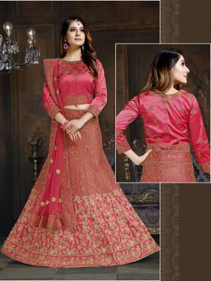 Shine Bright In This Attractive Looking Heavy Designer Lehenga Choli In Dark Pink Color. Its Blouse And Lehenga Are Satin Based Paired With Net Fabricated Dupatta. It Is Beautified With Heavy Coding And Stone Work. Buy Now.