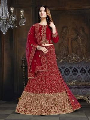 Get Ready For The Upcoming Wedding Season With This Very Beautiful Heavy Designer Lehenga Choli In All Over Red Color. Its Blouse And Lehenga Are Fabricated On Velvet Paired With Net Fabricated Dupatta. Buy Now.