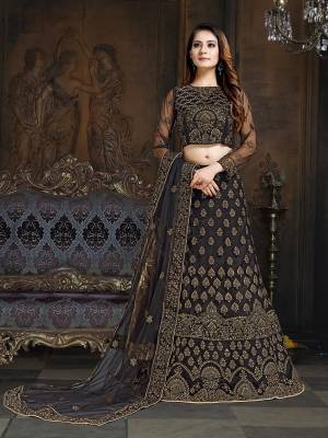 Here Is A Very Designer Lehenga Choli To Add Into Your Wardrobe For The Upcoming Wedding Season In Black. Its Pretty Blouse And Lehenga Are Fabricated On Net With Satin Inner Paired With Net Fabricated Dupatta. Its Bold Color And Heavy Embroidery Will Definitely Earn You Lots Of Compliments From Onlookers.