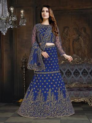 Here Is A Very Designer Lehenga Choli To Add Into Your Wardrobe For The Upcoming Wedding Season In Royal Blue. Its Pretty Blouse And Lehenga Are Fabricated On Net With Satin Inner Paired With Net Fabricated Dupatta. Its Pretty Color And Heavy Embroidery Will Definitely Earn You Lots Of Compliments From Onlookers.