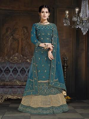 Shine Bright In This Attractive Looking Heavy Designer Lehenga Choli In Blue Color. Its Blouse And Lehenga Are Satin Based Paired With Net Fabricated Dupatta. It Is Beautified With Heavy Coding And Stone Work. Buy Now.