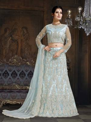 Here Is A Very Designer Lehenga Choli To Add Into Your Wardrobe For The Upcoming Wedding Season In Baby Blue. Its Pretty Blouse And Lehenga Are Fabricated On Net With Satin Inner Paired With Net Fabricated Dupatta. Its Pretty Color And Heavy Embroidery Will Definitely Earn You Lots Of Compliments From Onlookers.