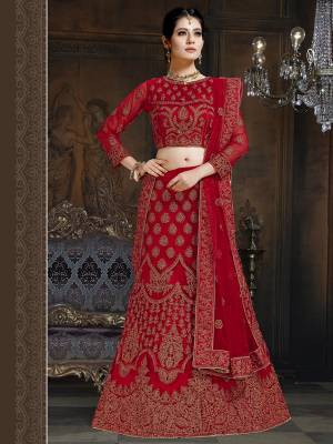 Here Is A Very Designer Lehenga Choli To Add Into Your Wardrobe For The Upcoming Wedding Season In Red. Its Pretty Blouse And Lehenga Are Fabricated On Net With Satin Inner Paired With Net Fabricated Dupatta. Its Pretty Color And Heavy Embroidery Will Definitely Earn You Lots Of Compliments From Onlookers.