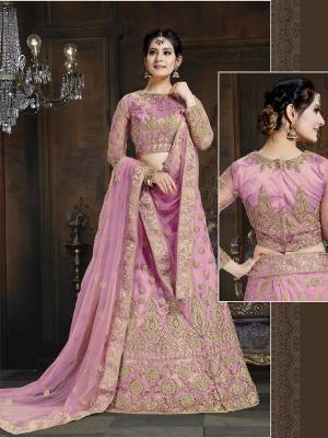 Here Is A Very Designer Lehenga Choli To Add Into Your Wardrobe For The Upcoming Wedding Season In Pink. Its Pretty Blouse And Lehenga Are Fabricated On Net With Satin Inner Paired With Net Fabricated Dupatta. Its Pretty Color And Heavy Embroidery Will Definitely Earn You Lots Of Compliments From Onlookers.