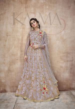 Flaunt Your Rich And Rich And Elegant Taste Wearing This Designer Heavy Floor Length Suit In All Over Grey. Its Heavy Embroidered Top Is Fabricated On Net Paired With Satin Silk Bottom And Net Fabricated Dupatta. Its Attractive Embroidery, Subtle Color And Designer Look Will Earn You Lots Of Compliments From Onlookers.