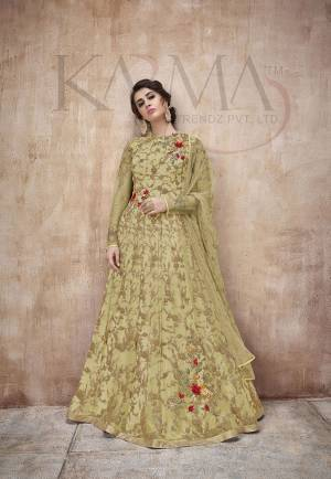 Flaunt Your Rich And Rich And Elegant Taste Wearing This Designer Heavy Floor Length Suit In All Over Pear Green. Its Heavy Embroidered Top Is Fabricated On Net Paired With Satin Silk Bottom And Net Fabricated Dupatta. Its Attractive Embroidery, Subtle Color And Designer Look Will Earn You Lots Of Compliments From Onlookers.