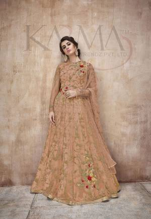 Flaunt Your Rich And Rich And Elegant Taste Wearing This Designer Heavy Floor Length Suit In All Over Orange. Its Heavy Embroidered Top Is Fabricated On Net Paired With Satin Silk Bottom And Net Fabricated Dupatta. Its Attractive Embroidery, Subtle Color And Designer Look Will Earn You Lots Of Compliments From Onlookers.