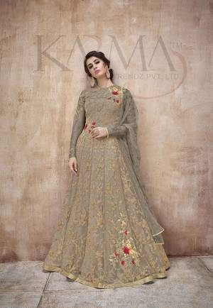 Flaunt Your Rich And Rich And Elegant Taste Wearing This Designer Heavy Floor Length Suit In All Over Dark Grey. Its Heavy Embroidered Top Is Fabricated On Net Paired With Satin Silk Bottom And Net Fabricated Dupatta. Its Attractive Embroidery, Subtle Color And Designer Look Will Earn You Lots Of Compliments From Onlookers.